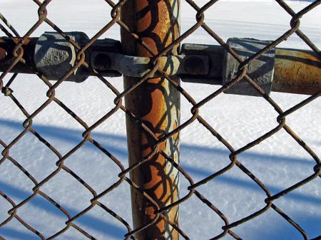 Rusty fence and snow
