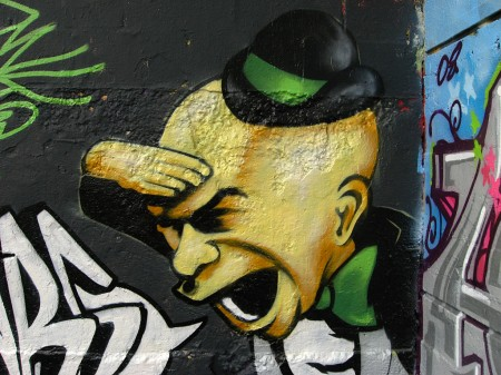 Graffiti head in bowler hat