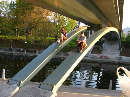 Milan Ilnyckyj and Emily Horn, sitting on bridge supports