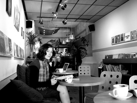 Emily at a coffee shop in Kensington Market, Toronto