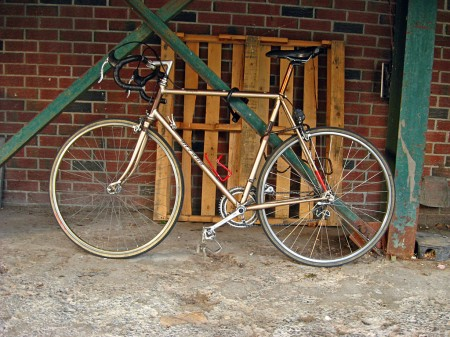 Road bike against brick wall