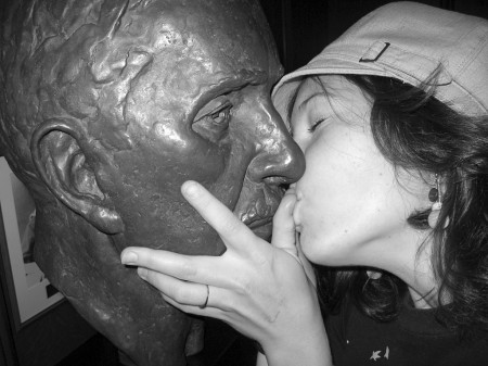 Emily Horn kissing a statue in the Supreme Court of Canada