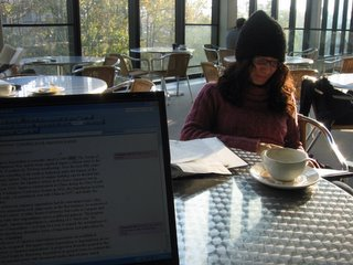 Editing papers in the Manor Road cafeteria