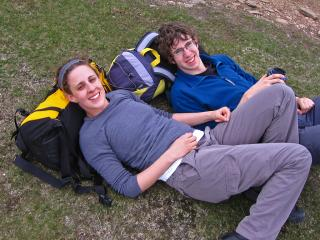 Sarah and Rob, reclining on packs