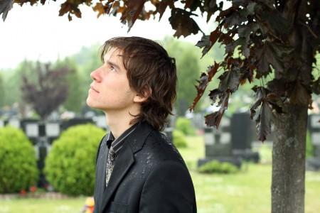 Sasha Ilnyckyj in a cemetery