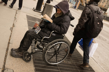 Man reading in wheelchair