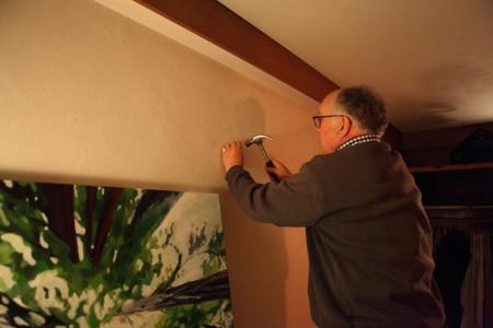 Master John Fraser hanging a painting