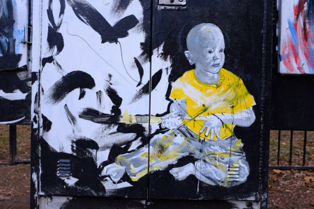 Graffito: yellow boy with paintbrush