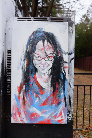 Graffito: girl in red and blue