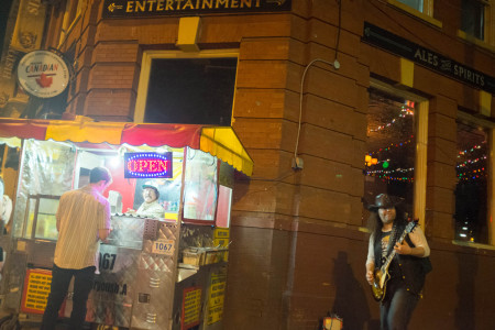 Busker and hot dog stand