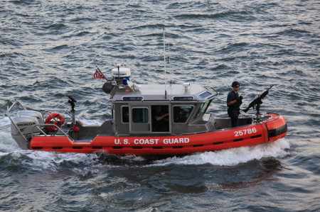 Coast Guard boat with mounted machine gun