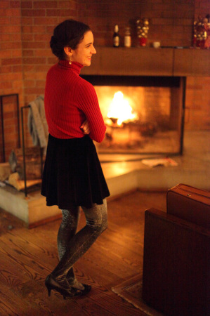 Clara Steinhagen in front of the fire