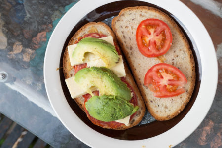 Salami, cheese, avocado, tomato sandwich